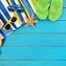 Beach scene with blue wood decking
