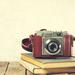 Old Vintage Camera on old books on Wooden Background. Old Vintag